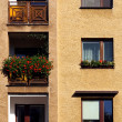Windows and balcony on yellow wall — Stock Photo