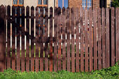 Shaded wooden fence — Stock Photo