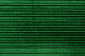 Green striped fabric texture or background — Stock Photo