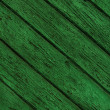 Green wooden background with peeling paint — Stock Photo