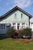 Front side of old village house — Stock Photo