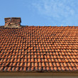 Old red tile roof with chimney — Stock Photo