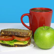 Stock Photo: Healthy lunch- sandwich, green apple and coffe in red cup