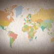 Colorful world map on brown paper background — Foto de Stock