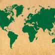 Green world map on cardboard background — Stock Photo
