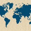 Blue world map on cream handmade paper texture — Stock Photo