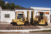 Two rusty forklifts in Port of Kissamos- Crete — Stock Photo