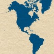 Map of North and South America- blue on yellow paper background — Stock Photo #38167651