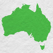 Green map of Australia on white paper texture — Stock Photo