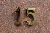 Number fifteen, house address plate number — Stock Photo