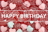 Happy Birthday text on candy background — Stock Photo