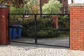 Black wrought gate — Stock Photo