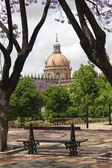 Park bench with cathedral in Jerez de la Frontera, Spain — Stock Photo