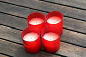 Red candles on wooden background — Stock Photo