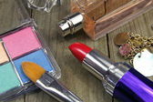 Women's accessories- red lipstick, eyeshadows, perfums and jewel — Stock Photo