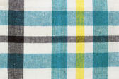 Blue checkered fabric background — Stock Photo