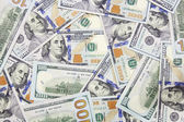 One hundred dollars banknotes background (new 2013 edition) — Stock Photo