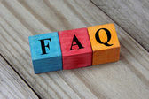 Concept of FAQ word on wooden colorful cubes — Foto Stock