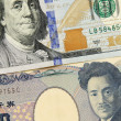 Closeup of american dollar and yen- concept of currency exchange — Stock Photo #51784673