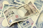 Selective focus on heap of japanese yen banknotes — Stock Photo