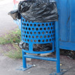 A blue trashcan — Stock Photo