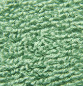 Green fluffy cloth close view — Stock Photo