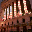 Wall Street Stock Exchange exceptionally decorated with US Flag Columns, Christmas Time - Stock Photo