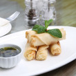 Spring roll with olive oil — Stock Photo