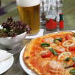 Seafood pizza with salad — Stock Photo