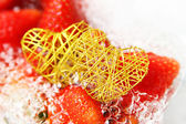 Fresh strawberries and heart — Stock Photo