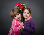 Children with red roses — Photo