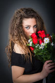 Romantic woman with red roses — Stock Photo