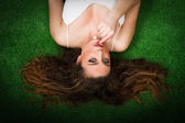 Woman on green grass alluring — Stock Photo