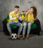 Vuvuzela for a football supporters couple — Stock Photo