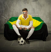 Video football gamer with 3d glasses — Stock Photo