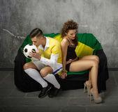Couple chosen football or love — Stock Photo