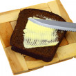 Black bread and butter — Stock Photo