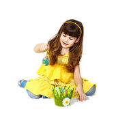 Girl plays with easter egg — Stock Photo