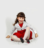 Cute girl sitting — Stock Photo