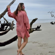 Woman Posing Next to Driftwood on Jekyll Island — Stock Photo #13501906