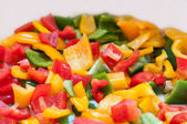 A lot of colored cut peppers on a platter — Foto de Stock