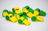 Whistles green and yellow brazilian colors — Stock Photo