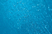 Water Drops on textured glass — Stock Photo