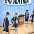 Medical school graduation in gown - Stock Photo