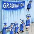 Graduates take off on wings - Stock Photo