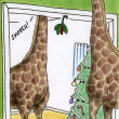 Giraffes kissing under the mistletoe - Stock Photo