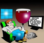A man holds a large glass of wine for health benefits — Стоковое фото