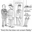Man in the dressing room trying on a hat — Stock Photo