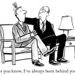 Boss puts rabbit ears on employee — Stock Photo