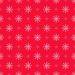 Seamless red pattern with snowflakes — Stock Vector